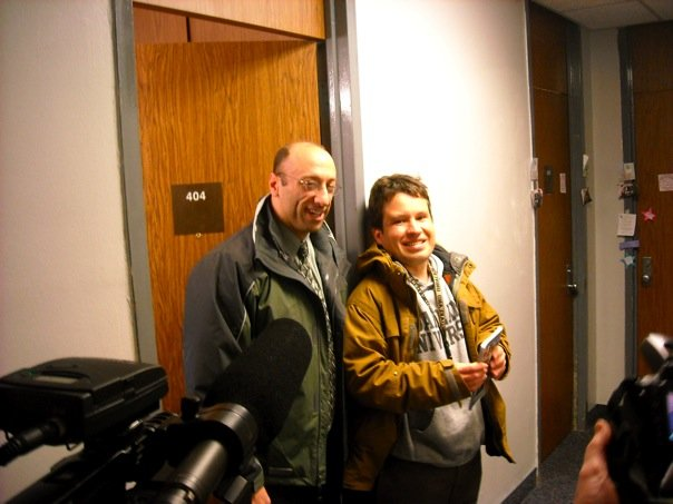 Micah with his lawyer Chris Davis in front of his dorm room at OU